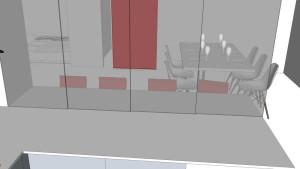 dettaglio della parete in vetro di divisione tra la cucina e la zona pranzo